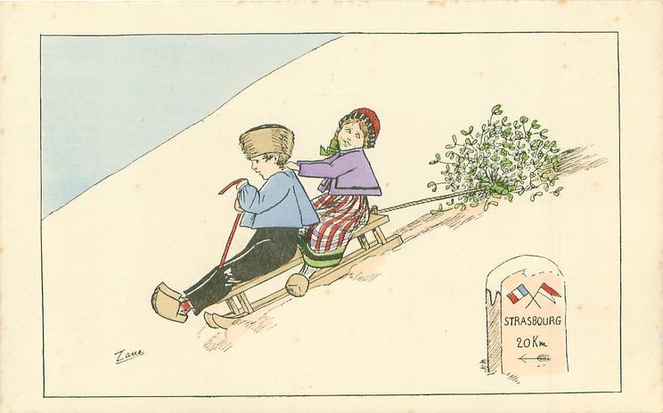 boy & girl toboggan downhill left towing mistletoe, sign showing STRASSBOURG 20 KM left
