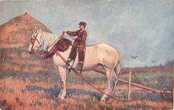boy rides sideways on horse pulling farm equipment left