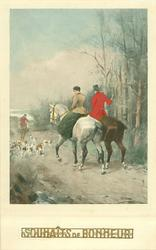 man & woman ride away left following the hounds on their way home