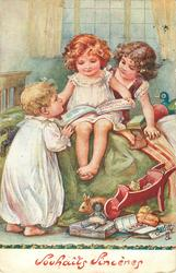 A HAPPY CHRISTMAS WITH LOVE  three children look at book, many toys & golly