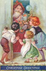CHRISTMAS GREETINGS  three children greet santa coming through door with toys