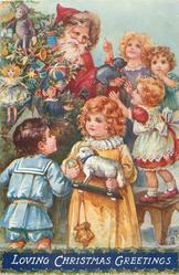 LOVING CHRISTMAS GREETINGS  many children, Santa behind tree gives out toys