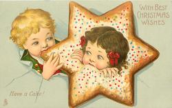 WITH BEST CHRISTMAS WISHES  boy & girl's heads in & next to star-shaped biscuit