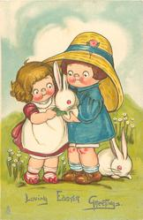 LOVING EASTER GREETINGS  girl & boy feed a leaf to rabbit, another on ground