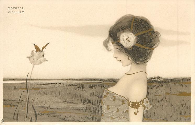 girl looks left at butterfly on flower