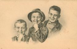 three boys, two on left with fingers to nose gesture