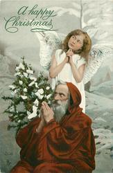 Santa on knees & angel behind both pray, tree left