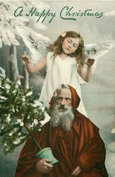 Santa sits front holding tree, angel behind