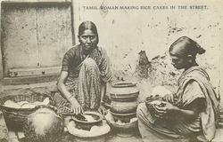 TAMIL WOMAN MAKING RICE CAKES IN THE STREET