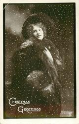 CHRISTMAS GREETINGS  pretty girl stands smiling in snow storm, wearing furs