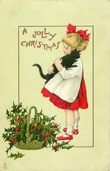 A JOLLY CHRISTMAS  girl carries black cat, basket of holly below