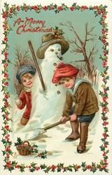 A MERRY CHRISTMAS  boys play near snowman