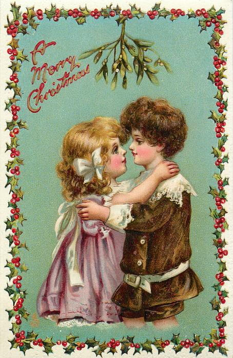 A MERRY CHRISTMAS boy & girl embrace under mistletoe