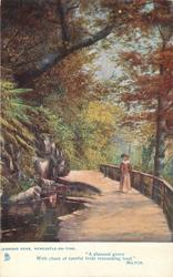 woman on path by stream