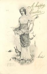 woman stands in meadow, carrying flowers & pussy willow, rabbit paws eggs below