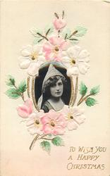TO WISH YOU A HAPPY CHRISTMAS  pink flowers surround photo-inset of girl