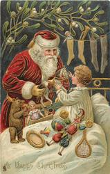 A HAPPY CHRISTMAS  Santa giving a horsetoy to a little boy, boy wearing white pyjamas, mistletoe above