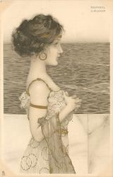 girl stands facing right, sea behind