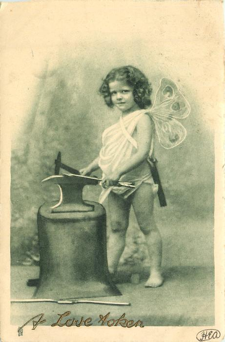 cupid faces left/forward whilst holding dart on anvil, hammer in right hand