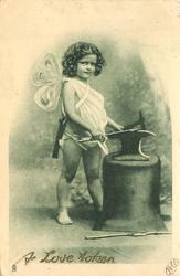 cupid faces right/forward whilst holding dart on anvil, hammer in right hand
