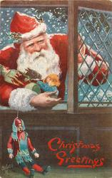 red robed Santa leans through window, armful of toys and puppet dangles