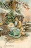 A HAPPY  CHRISTMAS  gold robed Santa  kneels by baby Jesus in a cot