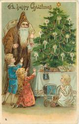 A HAPPY CHRISTMAS  brown robed Santa & three children admire Xmas tree