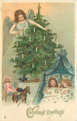 CHRISTMAS GREETINGS  angel  in blue to left of Christmas tree, two children asleep in bed below