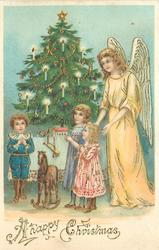 A HAPPY CHRISTMAS  angel in yellow stands right, three children & rocking horse stand in front of tree