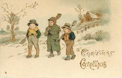 CHRISTMAS GREETINGS  three boys walk front left with shovels