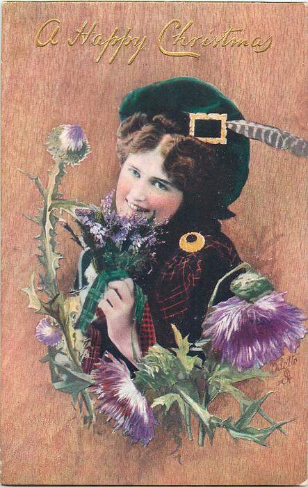 girl smelling a bunch of purple flower, thistles