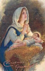 CHRISTMAS GREETINGS! or A HAPPY CHRISTMAS  Madonna prays over Jesus who is lying in the manger