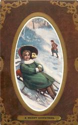 A MERRY CHRISTMAS girl sitting on sled, wearing green coat