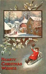 HEARTY CHRISTMAS WISHES  inset of village above girl on toboggan, mistletoe