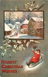HEARTY CHRISTMAS WISHES  inset of village above girl on toboggan, mistletoe