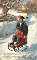 A HAPPY CHRISTMAS or PROSIT NEUJAHR  two boys on sled, one standing,  move front left, overprinted in gilt or red