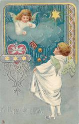 A HAPPY CHRISTMAS  angel child in cloud throws presents to another standing below, ornate design above