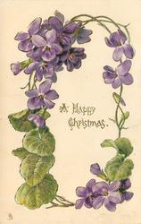 A HAPPY CHRISTMAS or A HAPPY NEW YEAR circlet of purple violets,  cluster of violets upper left