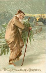 TO WISH YOU A HAPPY CHRISTMAS  brown robed Santa carrying tree walks up snowy lane