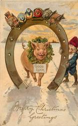MERRY CHRISTMAS GREETINGS, horseshoe frames pig wearing GOOD LUCK sign, dwarf right, birds above