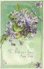TO WISH YOU A HAPPY NEW YEAR bunch of purple violets purple ribbon, green background, ornate border
