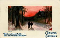 CHRISTMAS GREETINGS two people move away down snowy road, lighted cottage back right