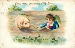 CHRISTMAS GREETING WITH LOVE  boy & pig  shake hands, both half through holes in fence