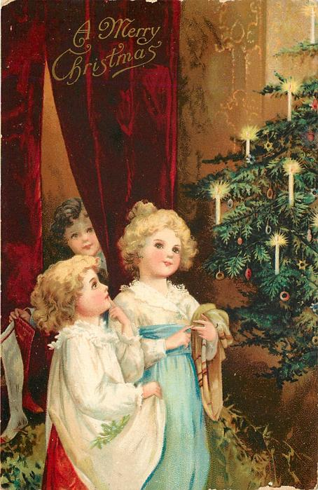 A MERRY CHRISTMAS  two girls with blond hair left of tree and another girl coming in
