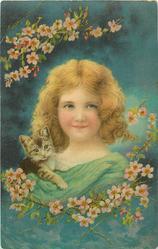 girl in green dress, kitten on shoulder, blossom above & below