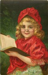 girl with book in hands, red cap and cape, glasses on end of her nose