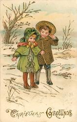 CHRISTMAS GREETINGS  young boy and girl stand in snow holding hands