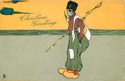CHRISTMAS GREETINGS, fisherman standing facing left, smoking pipe, in yellow clogs