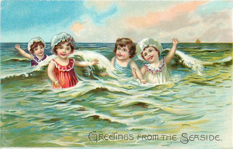 four children splash in waves, three have bonnets on