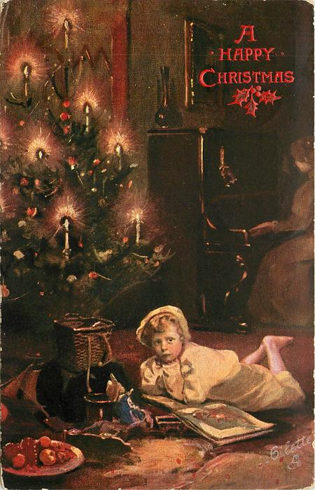 child looks up from book, lighted Xmas tree back left, oranges front left